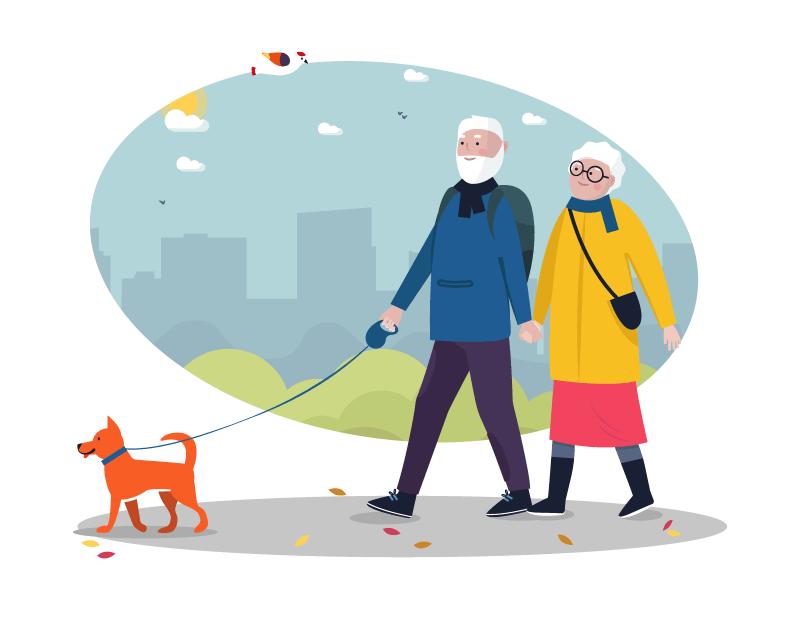 älteres Pärchen geht mit ihrem Hund spazieren