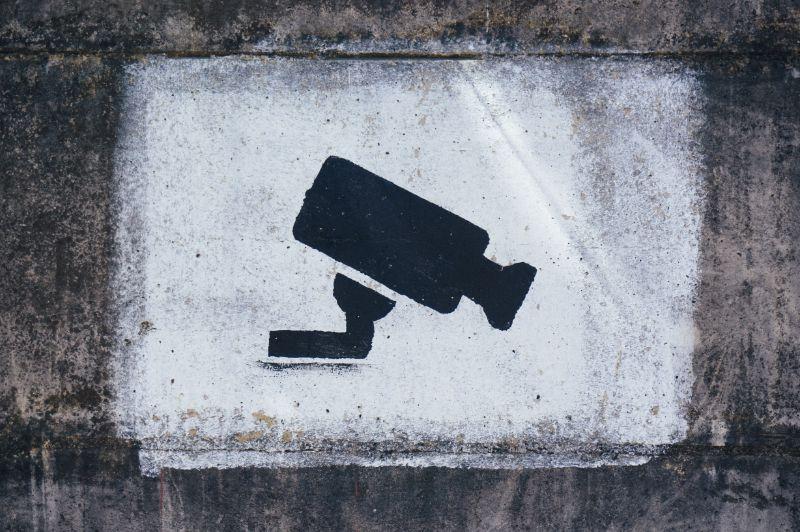 Graffiti-Bild einer Überwachungskamera